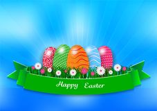 Easter holiday background with eggs and green grass on blue background, vector illustration.  Royalty Free Stock Photo