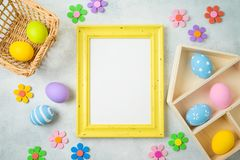 Easter holiday background with easter eggs and photo frame on table stock images