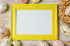 Easter holiday background with photo frame and modern eggs decorations. Royalty Free Stock Photography