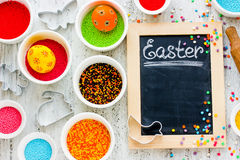 Easter holiday baking background with colored eggs Royalty Free Stock Photo