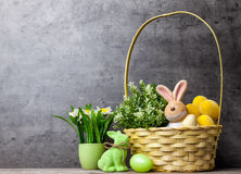 Easter holiday basket with a bunny, eggs and flowers Royalty Free Stock Photography