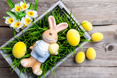 Easter holiday bunny with eggs and flowers Royalty Free Stock Photos
