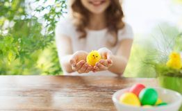 Close up of girl holding yellow toy chicken royalty free stock image