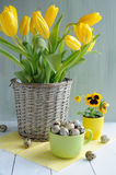 Easter holiday composition with yellow tulips on wooden table Stock Photos