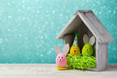 Easter holiday concept with cute handmade egg and bird house Stock Photography