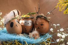 Easter holiday concept with cute handmade eggs, rabbit, chicks, owl, panda and deer. Creative eggs for Easter. Happy easter stock photo
