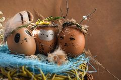 Easter holiday concept with cute handmade eggs, rabbit, chicks, owl, panda and deer. Creative eggs for Easter. Happy easter royalty free stock photo