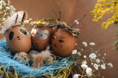 Easter holiday concept with cute handmade eggs, rabbit, chicks, owl, panda and deer. Creative eggs for Easter. Happy easter stock photos