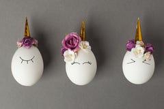 Easter holiday concept with cute handmade eggs, set of kawaii cute sleepy unicorns eggs.  royalty free stock photo