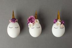 Easter holiday concept with cute handmade eggs, set of kawaii cute sleepy unicorns eggs.  royalty free stock photography