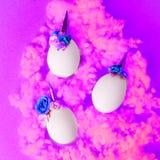 Easter holiday concept with cute handmade eggs, set of kawaii cute sleepy unicorns eggs.  stock photo