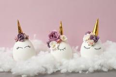 Easter holiday concept with cute handmade eggs, set of kawaii cute sleepy unicorns eggs stock photography