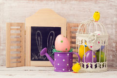 Easter holiday concept with egg decoration in bird cage Stock Photo
