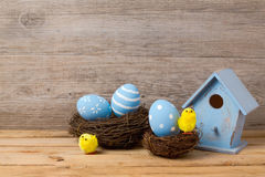 Easter holiday concept with handmade eggs decoration, bird house and nest Royalty Free Stock Photos