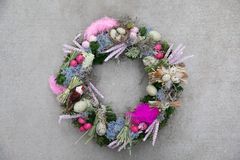 Easter holiday decor handmade wreath-stylish composition of spikelets of wheat, feathers, quail eggs for your home door stock images