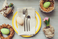 Easter holiday dinner at home. Table setting top view.. Handmade decoration details with hyacinth flowers and eggs Stock Image