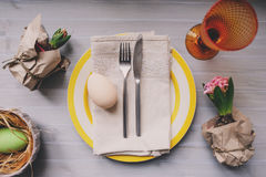 Easter holiday dinner at home. Table setting top view. Handmade decoration details with hyacinth flowers and eggs Stock Image