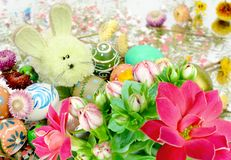 Easter eggs with a rabbit and flowers Stock Photos