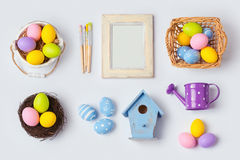 Easter holiday eggs decorations and photo frame for mock up template design. View from above. Stock Photos
