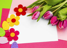 Easter holiday greeting with tulips and easter eggs decorations Royalty Free Stock Images