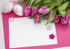Easter holiday greeting with tulips and easter eggs decorations Royalty Free Stock Photos