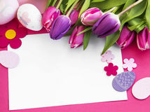 Easter holiday greeting with tulips and easter eggs decorations Stock Photos