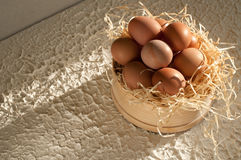 Easter holiday. sieve full of easter eggs on rustic wooden Stock Photos