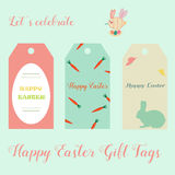 Easter holiday tags with eggs, rabbits, bright carrots. Easter holiday tags with eggs, cute rabbits, bright carrots Royalty Free Stock Images