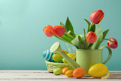 Easter holiday with tulip flowers and egg decorations in basket Stock Photos
