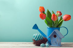Easter holiday with tulip flowers and egg decorations Stock Images
