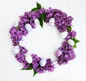 Easter holiday wreath. With eggs and lilac flowers stock photography