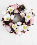 Easter holiday wreath. On a white wooden background stock images