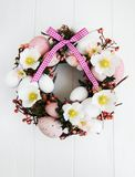 Easter holiday wreath. On a white wooden background stock photography
