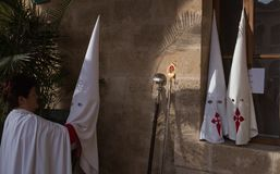 Easter holy week procession hoods and attire. Penitents hoods and attire seen before the start of the `Christ de la sang` easter holy week procession in Palma de royalty free stock images