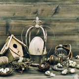 Easter home decoration with eggs, nest and birdcage Stock Photo