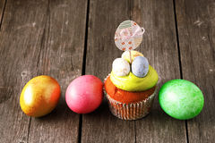 Easter homemade cupcake. Over wooden table Stock Images