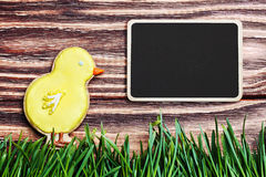Easter homemade gingerbread cookie and a blackboard Royalty Free Stock Photography