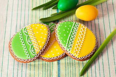 Easter homemade gingerbread cookie and eggs over napkin Royalty Free Stock Image
