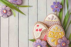 Easter homemade gingerbread cookie over white. Homemade cookies with icing in the shape of an egg for Easter. Delicious Easter cookies on a white background Royalty Free Stock Images