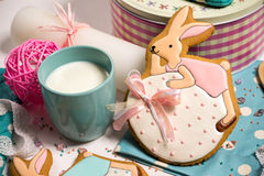 Easter honey-cake rabbit, cup milk, stylish kitchen, celebration food Royalty Free Stock Image