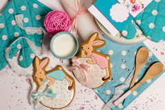 Easter honey-cake rabbits, blue stylish kitchen, celebration food cooking. Sweet nice easter honey-cake rabbits on eggs, pink blue style kitchen, celebration Stock Photos