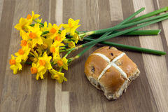 Easter hot cross bun. Easter hot cross bun with yellow narcissus Stock Images