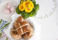 Easter hot cross buns. Are traditional spiced fruit buns filled with currants and raisins, covered with sticky glaze and decorated with pastry crosses on top stock images