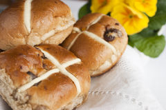 Easter hot cross buns. Are traditional spiced fruit buns filled with currants and raisins, covered with sticky glaze and decorated with pastry crosses on top stock photography