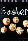 Easter hot cross buns. On black background Royalty Free Stock Photography