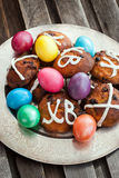 Easter hot cross buns and colored eggs Royalty Free Stock Images