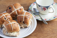 Easter hot cross buns and a cup of tea Stock Image