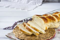 Easter hot cross buns with lavender flowers on napkin and wooden white and violet table. Easter baking Stock Image