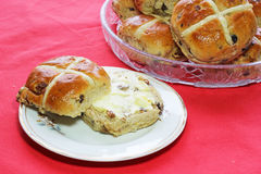 Easter hot cross buns. One with butter. Royalty Free Stock Images