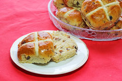 Easter hot cross buns. One cut in half. Stock Photo